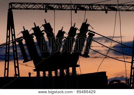 Power Line With Transformer At Sunset