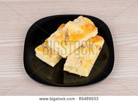 Three Pieces Of Apple Pie In Black Plate On Table