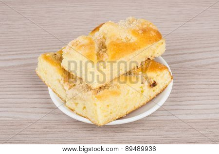 Three Pieces Of Apple Pie In Saucer On Table