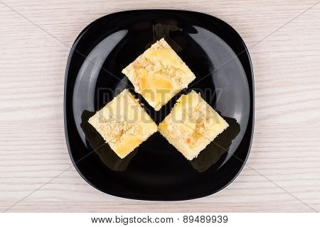 Small Pieces Of Pie In Black Glass Plate, Top View