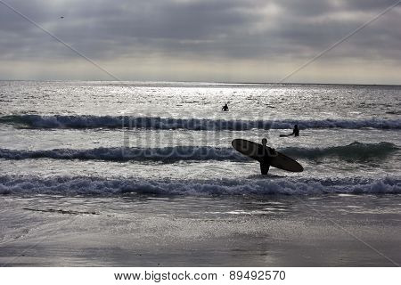 Surfer On The Shoreline Of San Diego Mission Beach