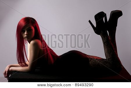 Beautiful Red Haired Woman Posing Over Grey Background