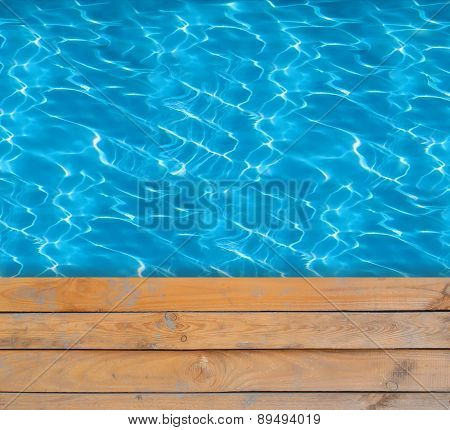Swimming Pool With Blue Clear Water And Wooden Deck