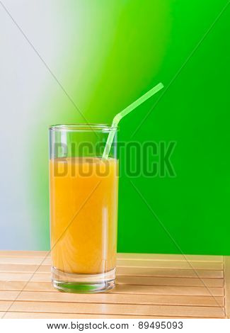 Orange Juice With Straw On The Wood Table Nutrition Concept