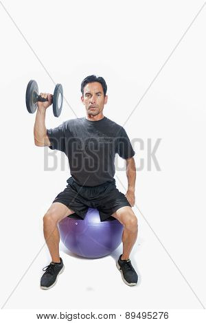 Dumbbell press seated on stability ball