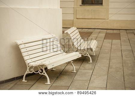 White benches.
