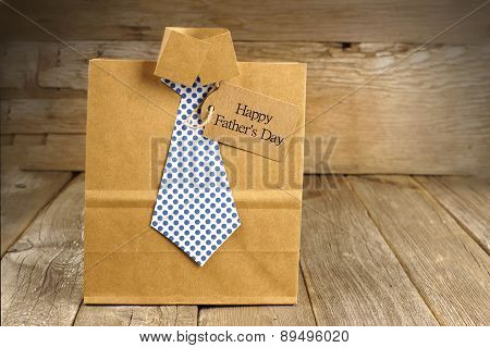 Fathers Day shirt and tie gift bag with wood background