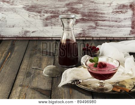 Cranberry jelly, cranberry juice and frozen cranberry on an old table background.Selective focus.
