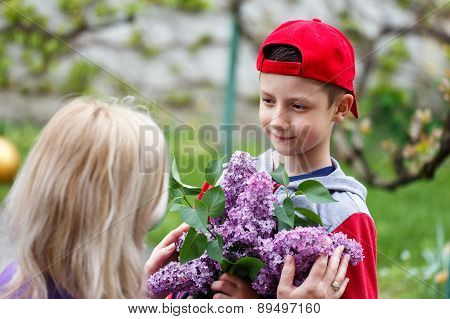 Little Boy In Red Cap Give Lilac Mother's Day