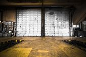 picture of garage  - a dirty oily door of the bus garage - JPG