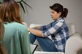 stock photo of visitation  - Young women at visit at her psychotherapist - JPG