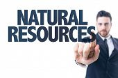 stock photo of biodiversity  - Business man pointing the text - JPG