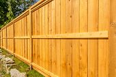 picture of wooden fence  - wooden fence with green lawn and houses - JPG