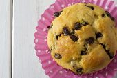 picture of chocolate muffin  - Single Chocolate Chip Muffin from Above with Pink Polka Dot Muffin Paper - JPG