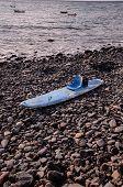 stock photo of modifier  - Handmade Modified Surf Board into a Kayak Boat - JPG