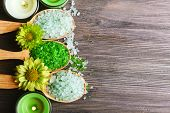 picture of sea salt  - Beautiful composition with sea salt in wooden spoons and flowers on table close up - JPG