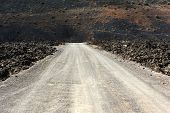 image of canary-islands  - a road on wild volcanic landscape at Lanzarote Island Canary Islands Spain - JPG