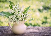 stock photo of lily  - Beautifyl bouquet of lilies of the valley on the table - JPG