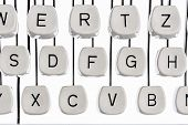 picture of groping  - keyboard letters and an old typewriter - JPG