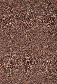 stock photo of mustard seeds  - Close up of Brown Mustard Seeds as background - JPG