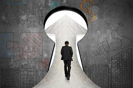 foto of keyholes  - Businessman walking on marble road toward keyhole door with business concept doodles concrete wall background - JPG