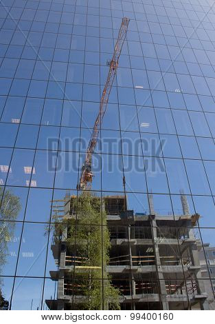 Building Site Mirrored In Glass Facade