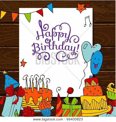 Happy Birthday card background with cakes on wooden table