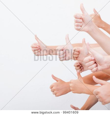 hands of teenagers showing okay sign on white