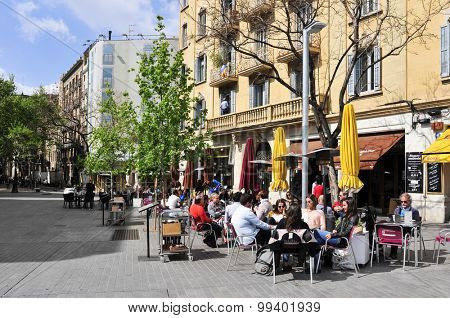 BARCELONA, SPAIN - APRIL 20: People in the restaurant terraces in Passeig del Born on April 20, 2015 in Barcelona, Spain. Born district is a popular area with stores and restaurants in the old town