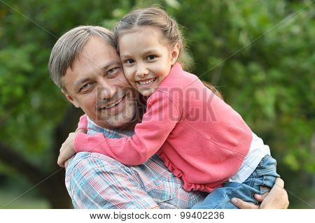 Father with daughter in summer park