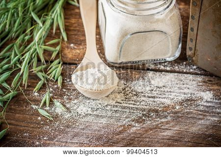 Oat flour, grain oats on wooden background