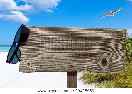 Wooden Signboard On The Sunny Beach