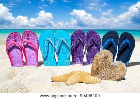 Flip Flops And Wooden Heart On The Beach