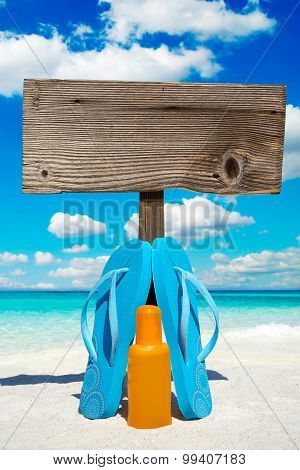 Wooden Signboard And Suntan Lotion