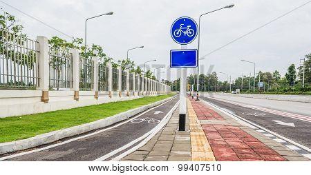 Asphalt Road And Bike Lane With Sign