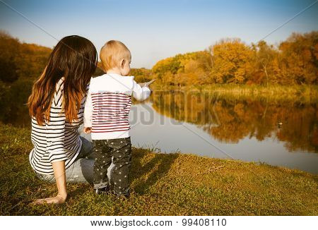Mother And Baby On Autumn Lake