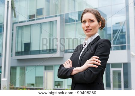 Young business woman portrait on the office building background