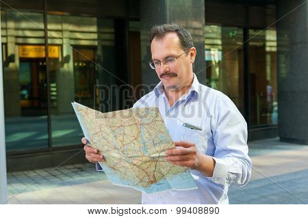 Middle age businessman exploring the city guide