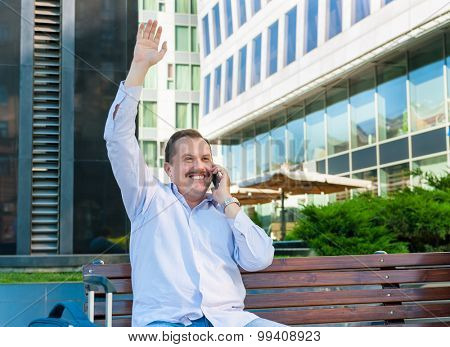 Businessman waving a hand to someone. He is glad to meet