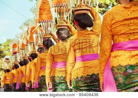Balinese Women Carry Ritual Offerings On Heads