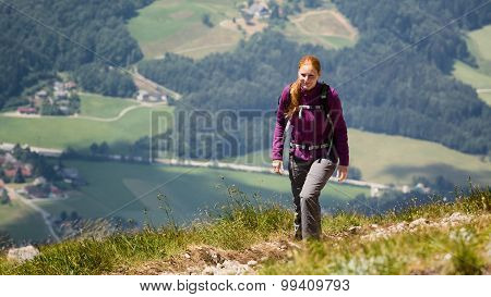 Woman Hiking Up A Mountain