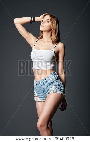 Fashion Shot: Beautiful Girl In Denim Shorts And Shirt