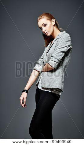 Studio Fashion Shot: Beautiful Young Girl In Leggings And Jacket