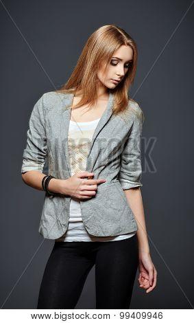 Studio Fashion Shot: Beautiful Young Woman In Leggings, Jacket And Shirt