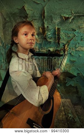 Child Playing Guitar Against Grunge Ruined Wall