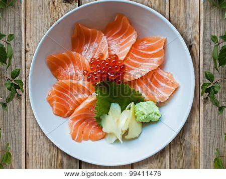 Salmon sashimi sushi put into white bowl