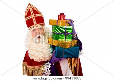 sinterklaas  with gifts . typical Dutch character part of a traditional event celebrating the birthday of Sinterklaas (Santa Claus) in december.