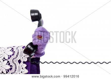 Hand of Sinterklaas with old vintage telephone. isolated on white background. Dutch character of Santa Claus