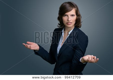 Confused Businesswoman With Hands In The Air