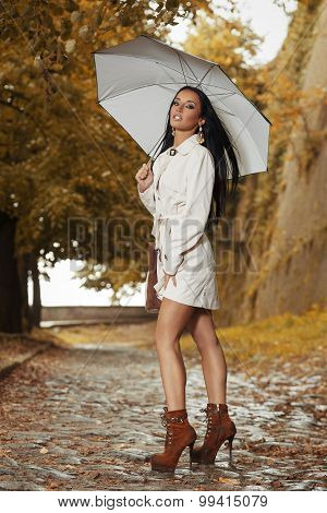 Beautiful Young Woman Posing With An Umbrella